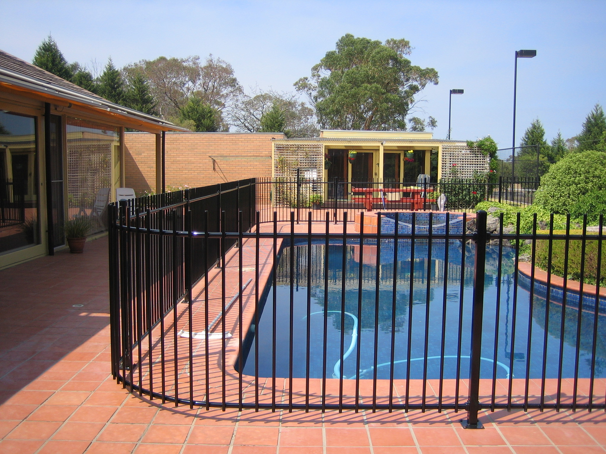 Pool fencing melbourne glass pool fences melbourne pool fencing curved steel pool fence baanklon Images