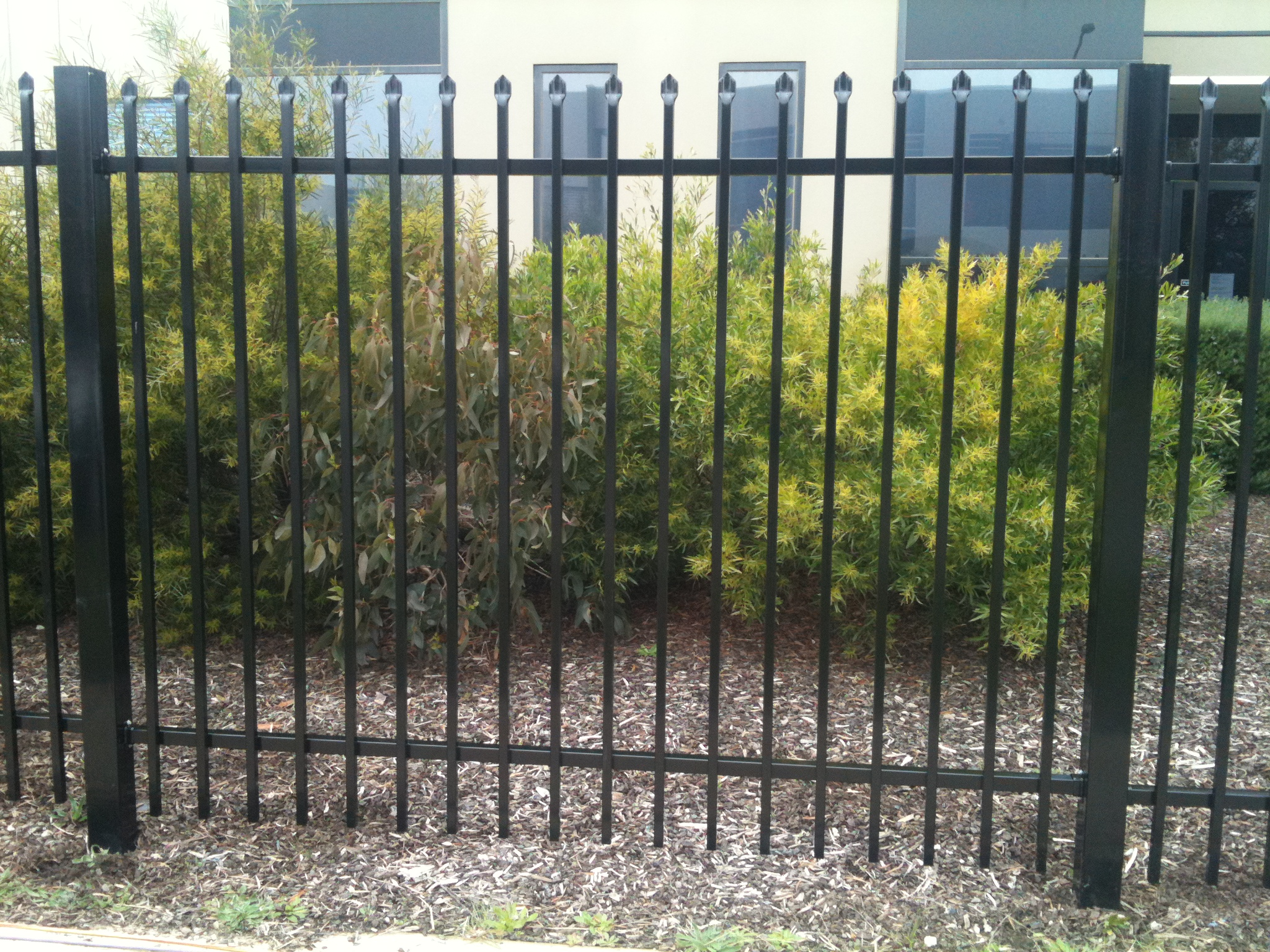 Pressed spear top security fencing