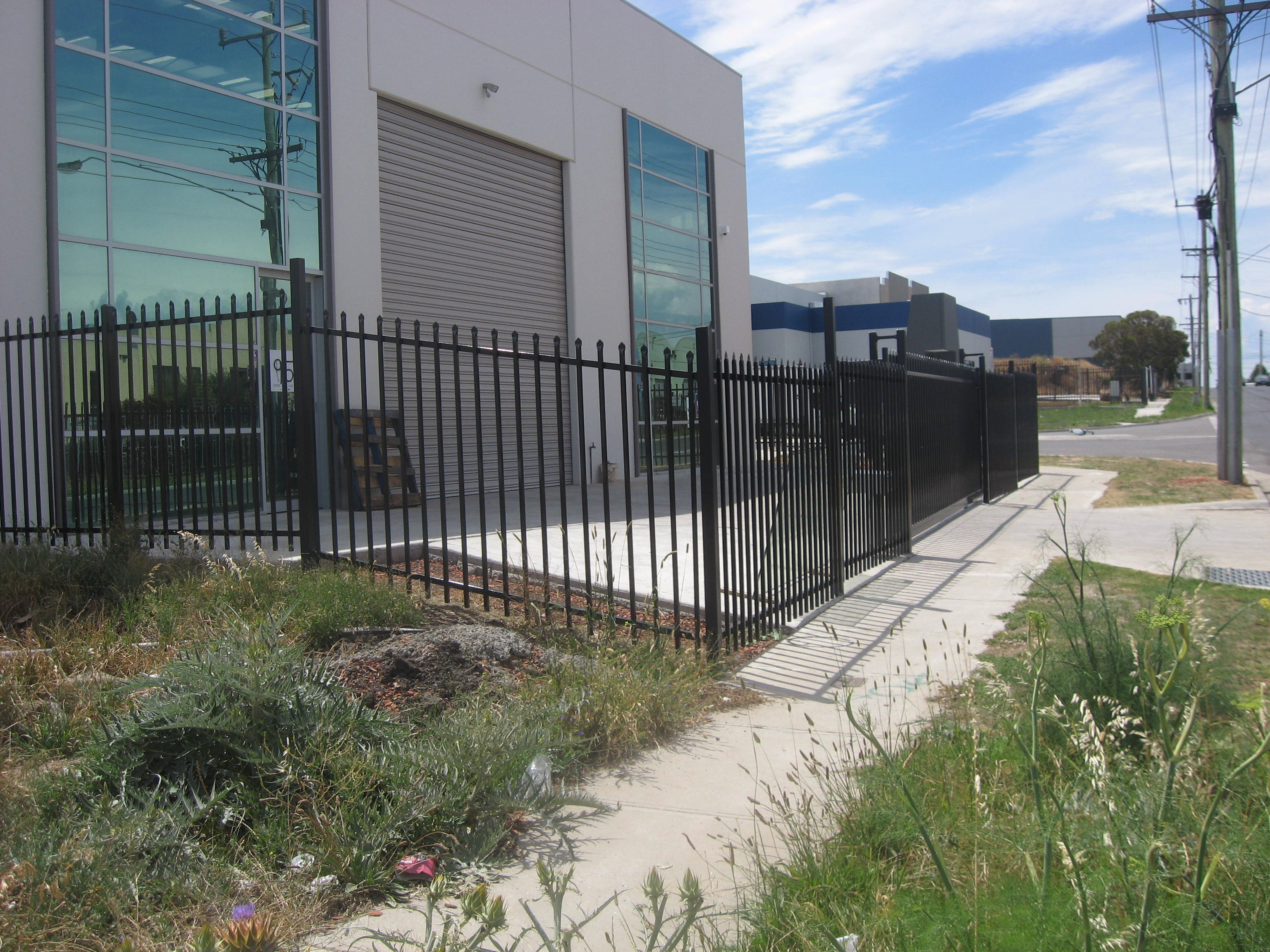 Security fence raked panel